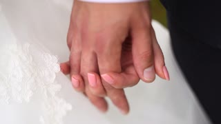 Bride And Groom Holding Hands on Their Wedding