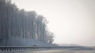 Cars go on the Road in Winter