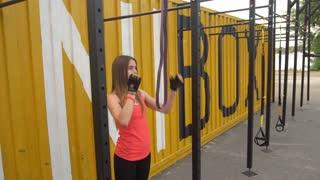 Sport Loving Girl Doing Pull Ups