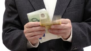 Businessman counting euro bills and put them in his wallet - 4k