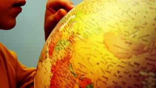 Globe and Child Hands - Mediterranean - 4k