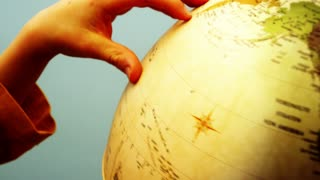 Globe and Childs Hands - 4k