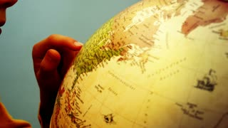 Globe and Childs Hands - USA - 4k
