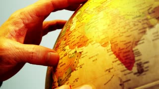 Globe and Male Hands - 4k