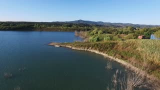 Aerial drone footage - flying over a lake in Italy