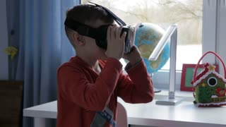 Boy in virtual reality goggles playing 360 degree game - 4k