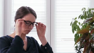 Overwork - a young businesswoman is tired and frustrated in office