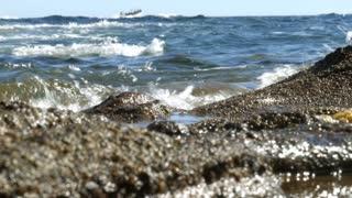 Peaceful waves splashing on stony beach - 4k