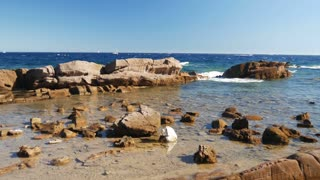 Sea landscape with rocks on a bright summer day - 4k