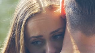 Young cute woman is being comforted by her boyfriend