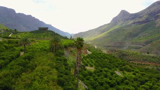 Flying above lush landscape and mountains at Gran Canaria