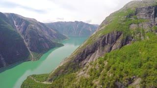 Flying between mountains in beautiful fjord in Hardanger Norway