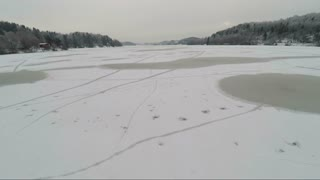 Flying over icy fresh water in the winter