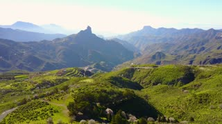 Flying over lush landscape and mountains at Gran Canaria