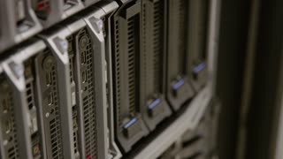 IT consultant power on a blade server in datacenter