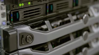 IT consultant power on a rack server in datacenter