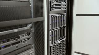 IT technician install harddrive in blade server in datacenter