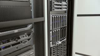 IT technician removes harddrive from blade server in datacenter