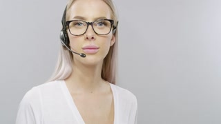 Smiling customer service or helpdesk woman with headset