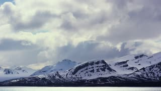 Timelapse of dramatic clouds over mountains in the arctic