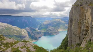 Tourists hiking at the Preikestolen cliff in lysefjorden Norway