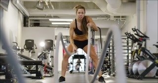 Athletic female high-intensity interval training using battle ropes