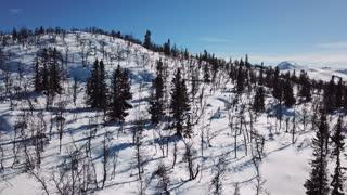 Cinematic camera motion in scenic mountain landscape in winter