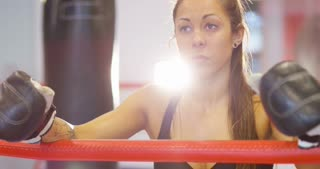 Close-up of real and powerful woman after a boxing workout