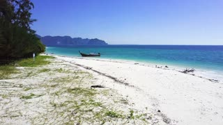 Long-tail boat on a beautiful beach at island in Krabi Thailand