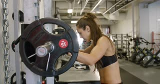 Powerful woman doing squats workout with heavy weights