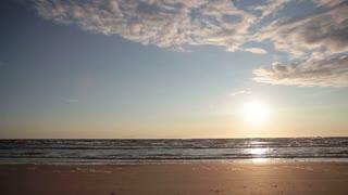 A beautiful pastel sunset on a sandy beach