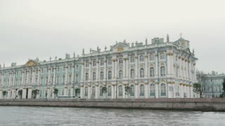 A view of Winter Palace on a river quay in St Petersburg, Russia. Beautiful building on a river bank