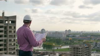 architect looking on project, turns off drawings