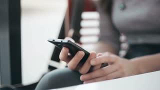 Beautiful woman using  smartphone in cafe.