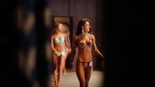 BELARUS. MINSK. 27 april 2015 Slender sexy girls posing in bikini on fitness competitions. The view from behind the scenes.