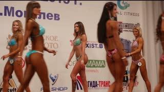 BELARUS. MOGILEV. 18 APRIL 2015. Slim female bodybuilder posing in bikini, fitness competition