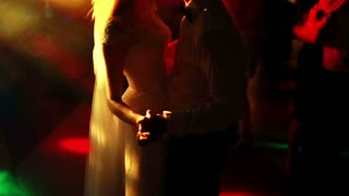 bride and groom dance in the spotlight. Slow mo