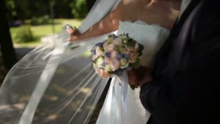bride and groom walking holding hands. slow motion
