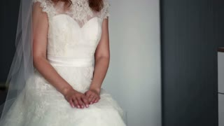 bride in a beautiful dress sitting on a chair