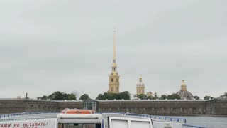 City sights in St Petersburg. A view of the Peter and Paul Fortress from a river bus turning left near a quay, slow mo