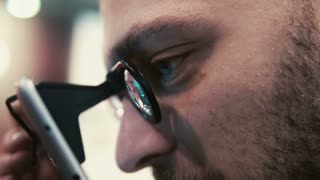 Close-up bearded attractive man uses virtual reality glasses