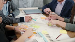 Close up brainstorm group of young architects Creative business team meeting in startup office discussing new ideas