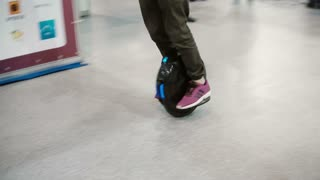 . Close-up of boy legs riding solowheelsegway - electric unicycle. 4K