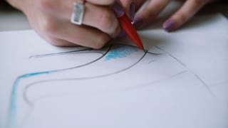 Close-up view of layout of woman s shoes drawing by young designer. Woman developing new collection. 4K