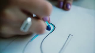 Close-up view of woman s hand coloring layout of shoes with blue pencil. Young designer developing new collection. 4K