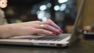 Closeup hands. Businesswoman working on laptop in modern cafe 4k