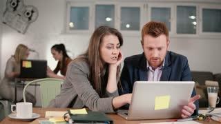 Diverse people group teamwork using digital display. Creative business team meeting in modern informal start up office