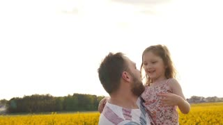 father and daughter at the flower field. Slow mo