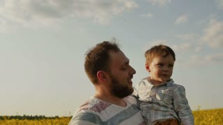 Father playing with son at field. slow motion