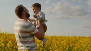 Father throwing son in air. slow motion